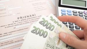 Man hold six thousands of Czech crown (CZK) against Czech declaration of corporation taxes. Corrupt practices concept. Selective focus on money.
